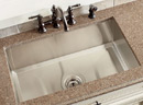 Kitchen sink with modern faucet fixture.